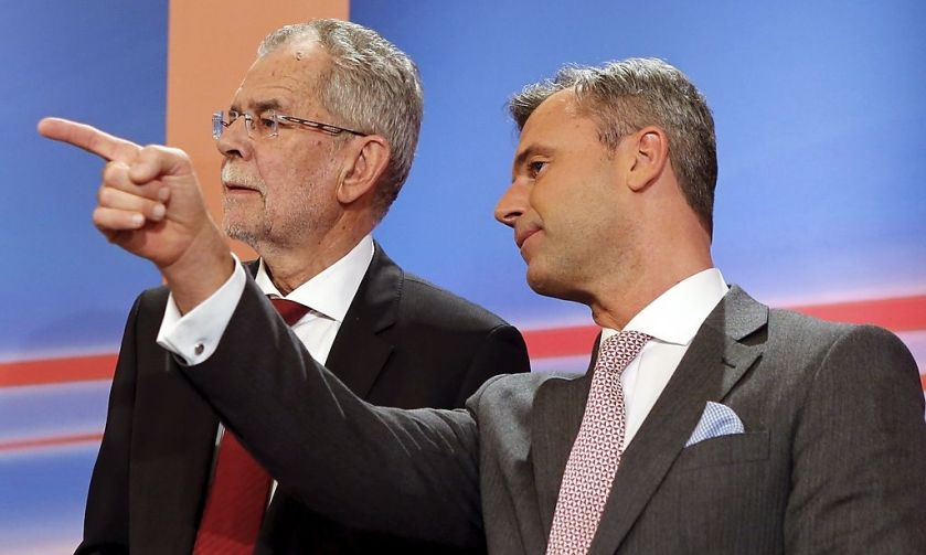 Presidential candidates Alexander van der Bellen and Norbert Hofer react during a TV debate in Vienna